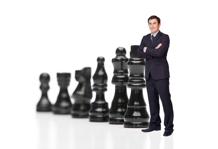 chess king: Businessman in front of black chess pieces