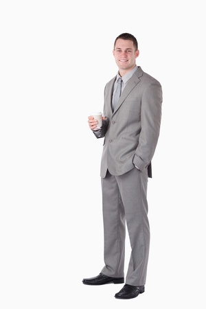 Portrait of a businessman holding a cup of coffee against a white background Stock Photo - 11618805