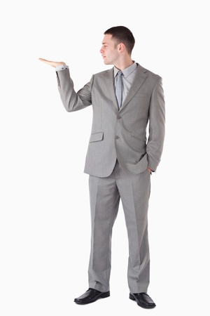 Portrait of a businessman presenting something against a white background