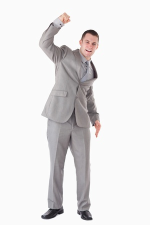 Portrait of a businessman cheering up against a white background Stock Photo - 11618780