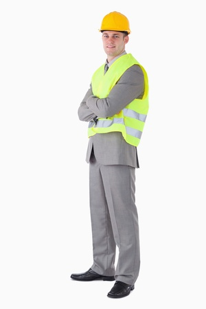 Portrait of a young builder against a white background