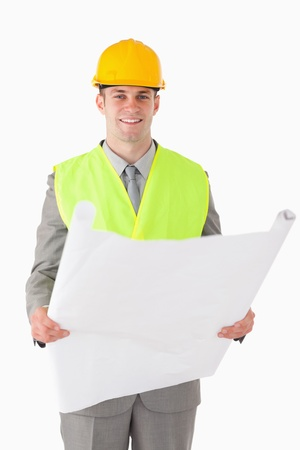 Portrait of a builder looking at a plan against a white background Stock Photo