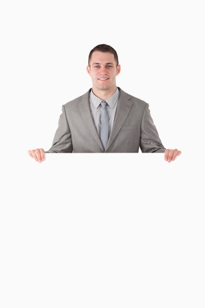 Portrait of a businessman behind a blank panel against a white background Stock Photo - 11618667
