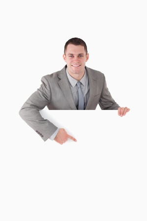 Portrait of a smiling entrepreneur pointing at something against a white background Stock Photo - 11618669
