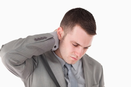 Tired young businessman against a white background Stock Photo - 11619276
