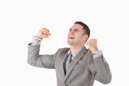 Businessman with his fists up against a white background Stock Photo