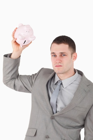 Portrait of a businessman shaking an empty piggy bank against a white background Stock Photo - 11619621