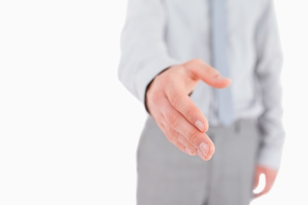 Businessman giving his hand with the camera focus on his hand