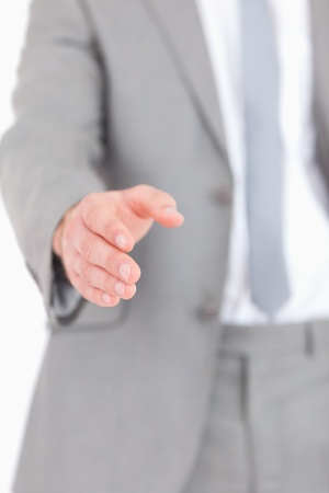 Portrait of a masculine hand ready for a handshake against a white background photo