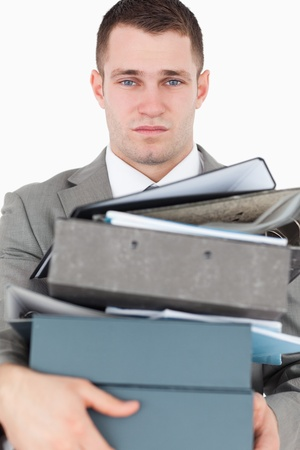 Portrait of a overwhelmed young businessman against a white background photo