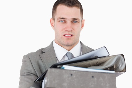 Overwhelmed young businessman against a white background