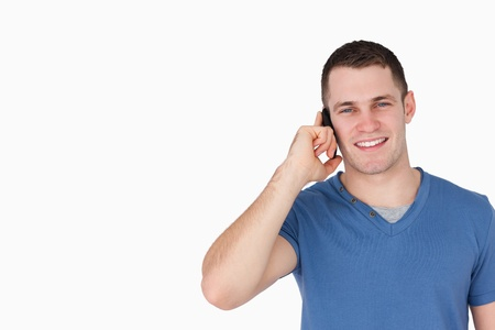 Smiling man on the phone against a white background