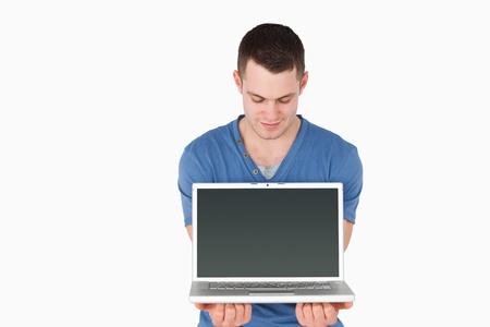 Man looking at a laptop against a white background Stock Photo