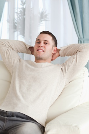 Portrait of a man relaxing on a sofa in his living room Stock Photo - 11619975