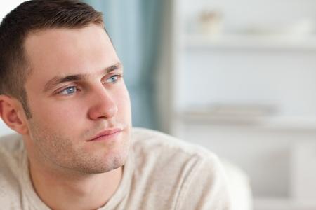 good looking man: Good looking man posing in his living room Stock Photo
