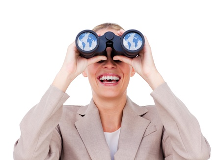 Joyful businesswoman predicting future success through binoculars isolated on a white background photo