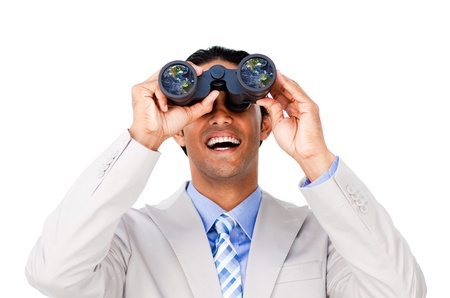 Happy businessman looking through binoculars against a white background photo