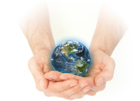 Masculine hands holding the Earth against a white background photo