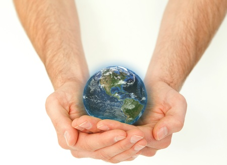 Masculine hands holding a planet globe against a white background photo