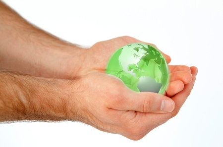 Masculine hands holding a 3d planet globe against a white background photo