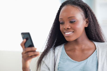 Close up of smiling woman reading a text message photo