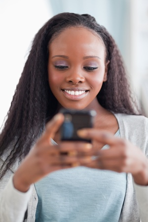 the message is text: Close up of happy smiling woman reading text message Stock Photo