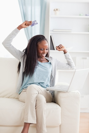 Smiling woman cheering about what she bought online photo