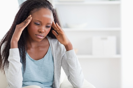 shiver: Young woman experiencing a headache