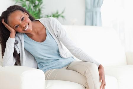armrest: Smiling woman leaning on armrest