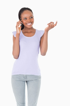 Close up of smiling woman talking on the phone on white background photo
