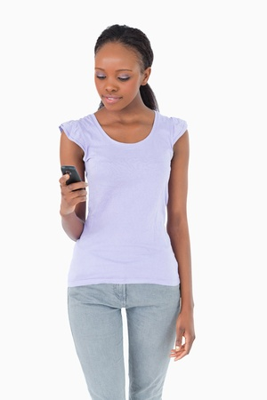 Close up of young woman texting on white background Stock Photo - 11619100