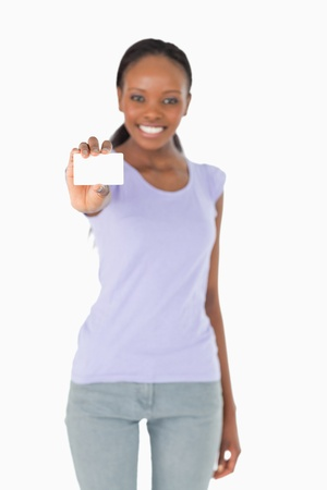 Business card being presented by smiling woman on white background photo