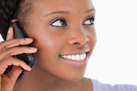 caller: Close up of smiling woman listening to caller on white background Stock Photo