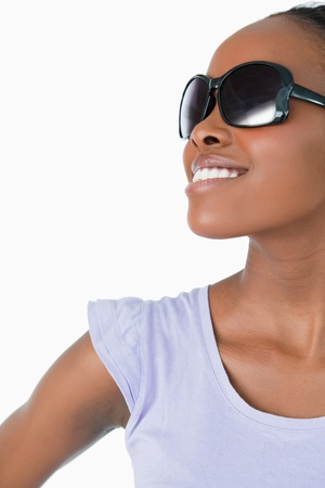 Close up of smiling woman wearing sunglasses on white background photo