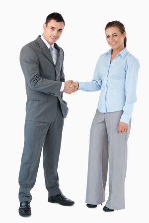 Young business partner greeting each other against a white background photo
