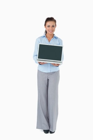 Smiling businesswoman presenting laptop against a white background photo