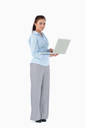 Young businesswoman with her laptop against a white background photo