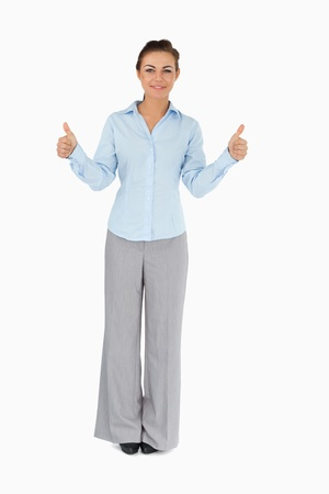 Businesswoman giving thumbs up against a white background Stock Photo - 11623654