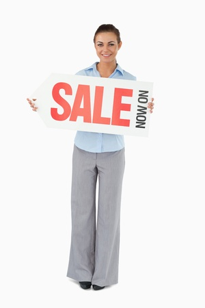 Businesswoman holding sign against a white background photo