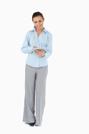 Smiling businesswoman with tablet against a white background photo