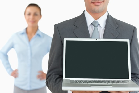 Business team with laptop against a white background photo