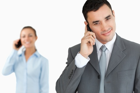 Business partners on the phone against a white background photo