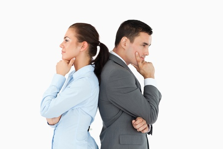 Thinking business partners back-to-back against a white background photo