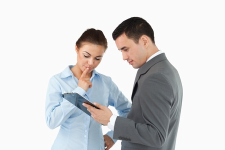Business partners analyzing document on the clipboard against a white background photo