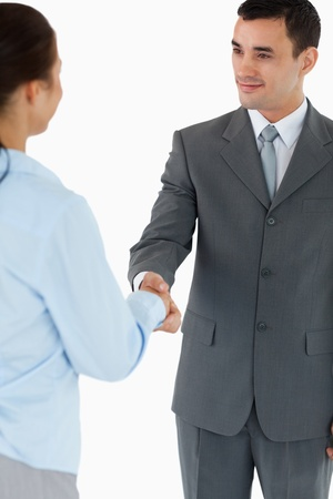 Business partners agreeing on a deal against a white background photo