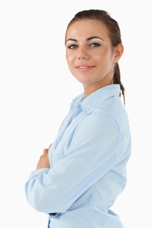 Side view of businesswoman with arms folded against a white background Stock Photo - 11624708