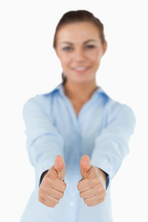 Businesswoman giving both thumbs up against a white background Stock Photo - 11624733