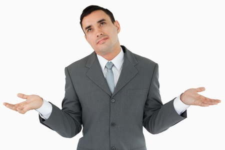 Businessman has no clue against a white background photo