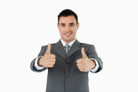 Businessman approving against a white background photo