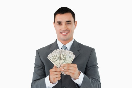 Businessman with money against a white background photo